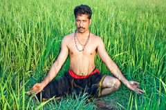 Man have a meditation in rice field Stock Photos