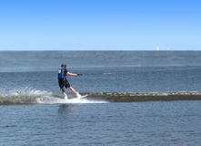 Man have wakeboarding in open sea. Wth two yachts on horizon Royalty Free Stock Image