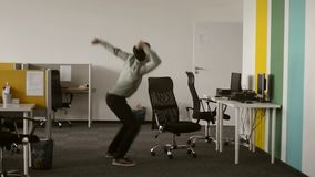 man have won s big prize dancing and laughing worker enjoying the end of the workday just a huge he is at office was waiting stock footage