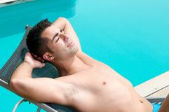 Man Having A Sun Bath Near A Swimming Pool Royalty Free Stock Image