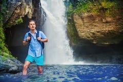 Man having an adventurous tracking. Near the waterfall Stock Photo