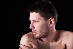 Man having arm pain Royalty Free Stock Photos