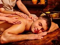 Man having Ayurvedic spa treatment Royalty Free Stock Photography