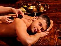 Man having Ayurvedic spa treatment Royalty Free Stock Image
