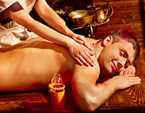 Man having Ayurvedic spa treatment. Royalty Free Stock Photography