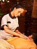 Man having Ayurvedic spa treatment. Royalty Free Stock Image