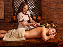 Man having Ayurvedic spa treatment. Royalty Free Stock Images