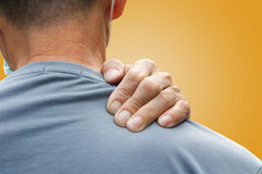 Man having a back ache stock photography