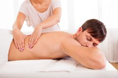 Man having a back massage stock photography