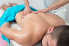 Man Having Back Massage In A Spa Center Royalty Free Stock Photography