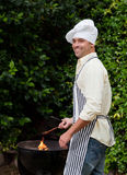 Man having a barbecue Royalty Free Stock Photo