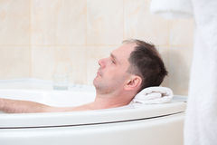 Man having a bath Royalty Free Stock Images