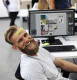 Man Having Be Happy Sticky Note on Forehead Durin Office Break Time royalty free stock photography