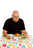 Man having breakfast Stock Image