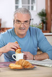 Man having breakfast Royalty Free Stock Photos