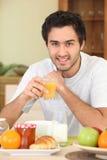 Man having breakfast Stock Photography