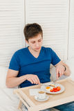 Man having Breakfast in bed Royalty Free Stock Images