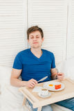 Man having Breakfast in bed Royalty Free Stock Image