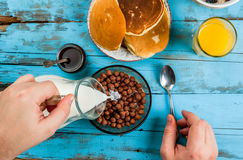 Man having breakfast with cereal chocolate balls royalty free stock photo