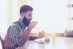 Man having breakfast with cup of coffee Stock Photos