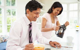 Man Having Breakfast Before Going To Work Stock Photography