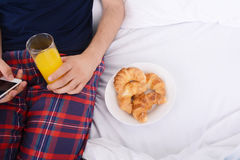 Man having breakfast and using phone. Stock Images