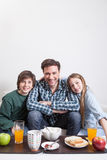 Man having a breakfast with your two childrens Stock Images