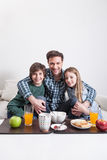 Man having a breakfast with your two childrens Stock Photography