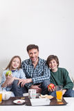 Man having a breakfast with your two childrens Royalty Free Stock Photo