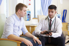 Man Having Chemotherapy With Doctor Using Digital Tablet royalty free stock images