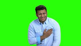 Man having chest pain on green screen. Young man suffering from heart ache. Heart disease concept stock video footage