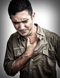 Man having a chest pain or heart attack. Grunge image of a man having a chest pain or heart attack royalty free stock photo