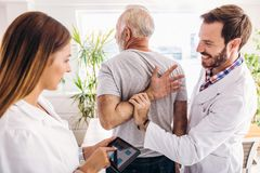 Man having chiropractic arm adjustment. royalty free stock photography