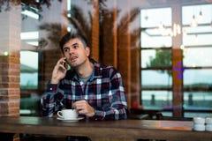 Man having coffee in the bar stock image