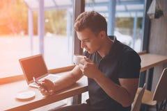 Man having a coffee break in modern cafe Royalty Free Stock Photos