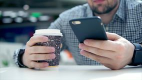 Man having coffee break and texting on cellphone stock video footage