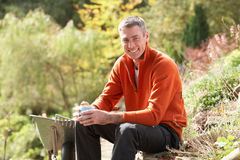 Man Having Coffee Break Whilst Working Outdoors royalty free stock photography