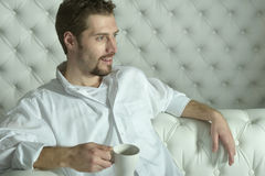 Man  having coffee at home Stock Images
