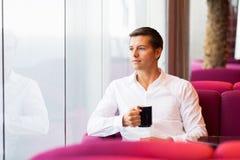 Man having coffee Stock Images