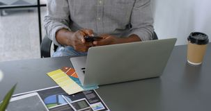 Man having coffee while using mobile phone on desk 4k. Man having coffee while using mobile phone on desk at office 4k stock footage