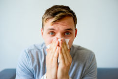 Man having cold. A portrait of an ill man having cold Royalty Free Stock Image