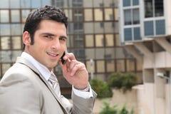 Man having conversation on phone. Young man having conversation on phone Stock Images