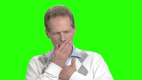 Man having cough attack, green background. Mature man suffering from cough on chroma key background. Allergy or asthma symptoms stock video