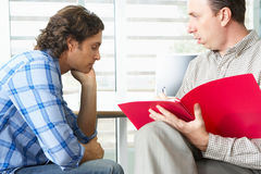 Man Having Counselling Session. With Male Counsellor Stock Photo