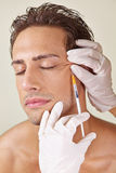 Man having crows feet removed Royalty Free Stock Photos