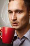 Man having a cup of coffee Stock Images