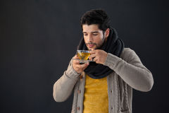 Man having a cup of lemon tea Stock Photo