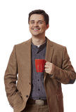 Man having cup of tea on white background Stock Photography