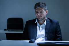 Man having depression at work Stock Photo