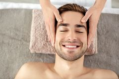 Man having face massage in salon. Man having face massage in spa salon royalty free stock photo